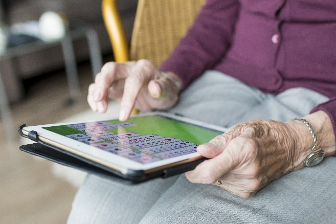 person writing on a tablet